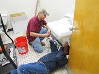 Don Matthews and Wesley Bassett completing the ADA batroom at Myer School