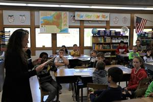 Storytelling Coach awards certificates to all fourth-grade students