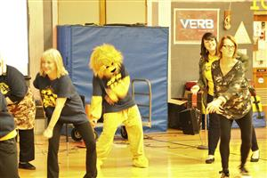 JFK faculty and mascot perform flash mob dance