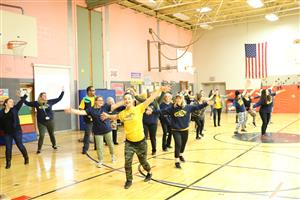 JFK faculty perform a flash mob dance