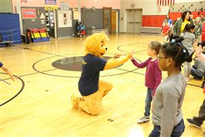 Roar gives high-fives to JFK students