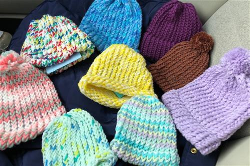 Handmade baby hats by Robert Graves students