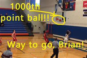 Brian Moore scores his 1000th varsity basketball point